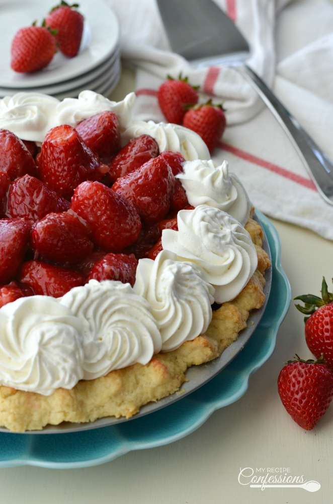 Fresh Strawberry Pie is the BEST pie ever! The fresh sliced strawberries and the homemade glaze is incredibly amazing! The strawberry filling and flaky crust topped with whipped cream makes this pie the BEST there is!