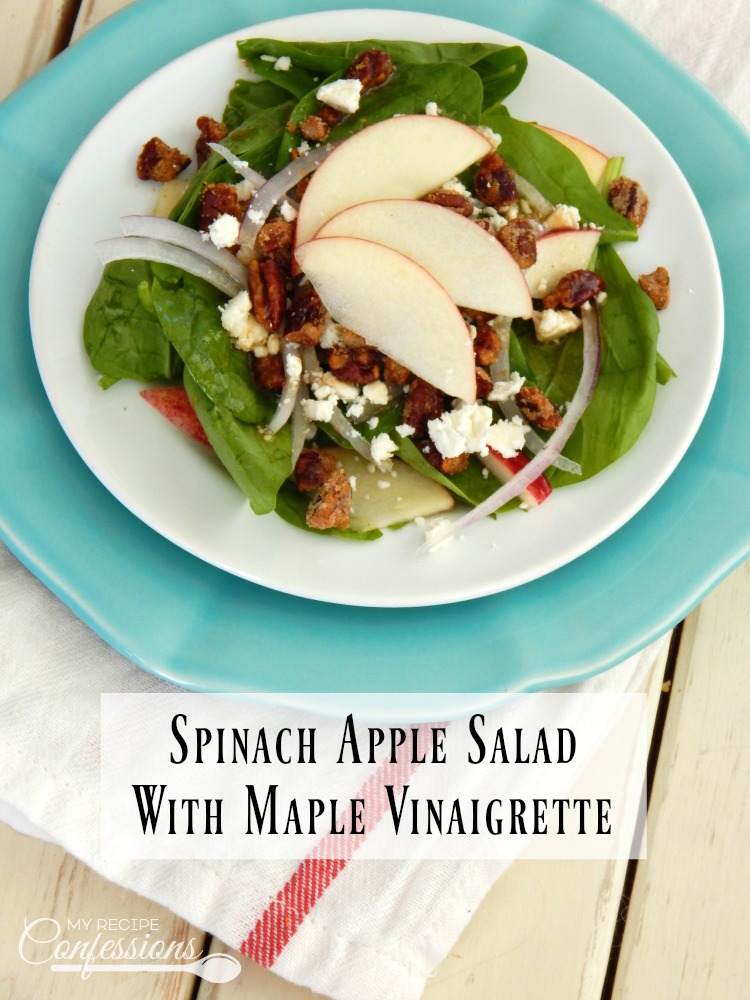 Spinach Apple Salad with Maple Syrup Vinaigrette- Apples, onions, feta cheese, and candied pecans over a bed of spinach with a maple syrup vinaigrette drizzled over the top. This is the best salad recipe! The dressing is super easy to make and it will rock your world!