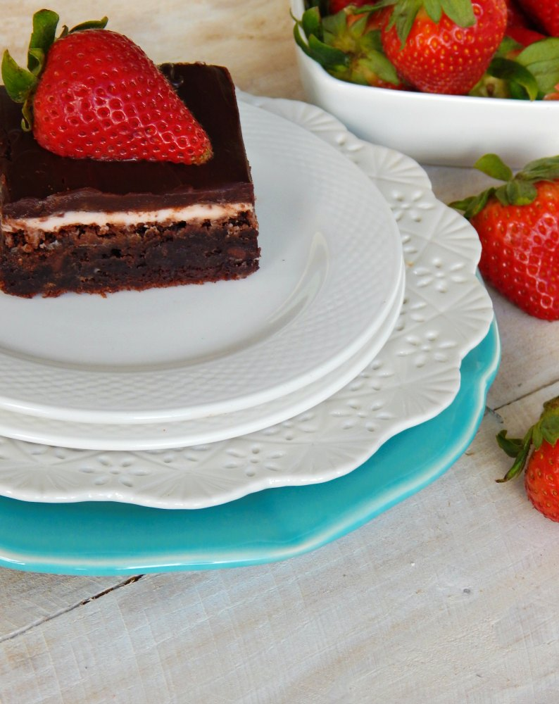 Every time I think about these Strawberry and Cream Brownies my mouth starts watering. They taste like a chocolate dipped strawberry. This is one of the best dessert recipes out there. End your summer the right way with a batch of these brownies.