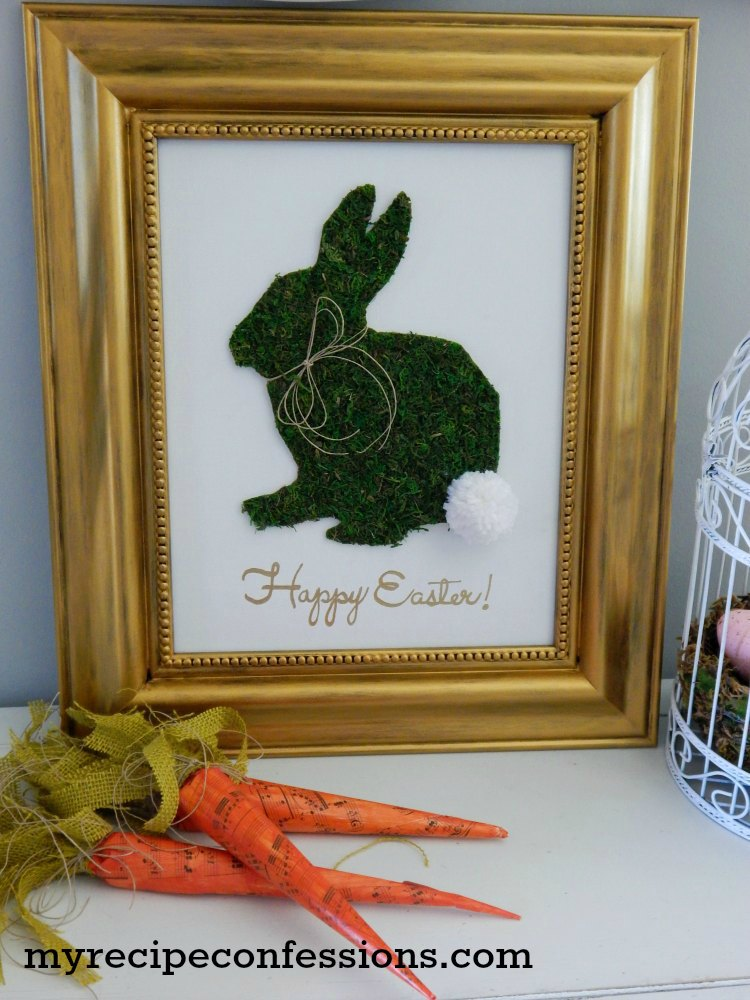 Moss Easter Bunny Sign. Don't pay an arm and a leg for you Easter home décor, when you can diy. This moss Easter bunny sign is so inexpensive to make, not to mention incredibly easy. You don't have to be a crafts expert to make this sign. Trust me, anybody can do it!