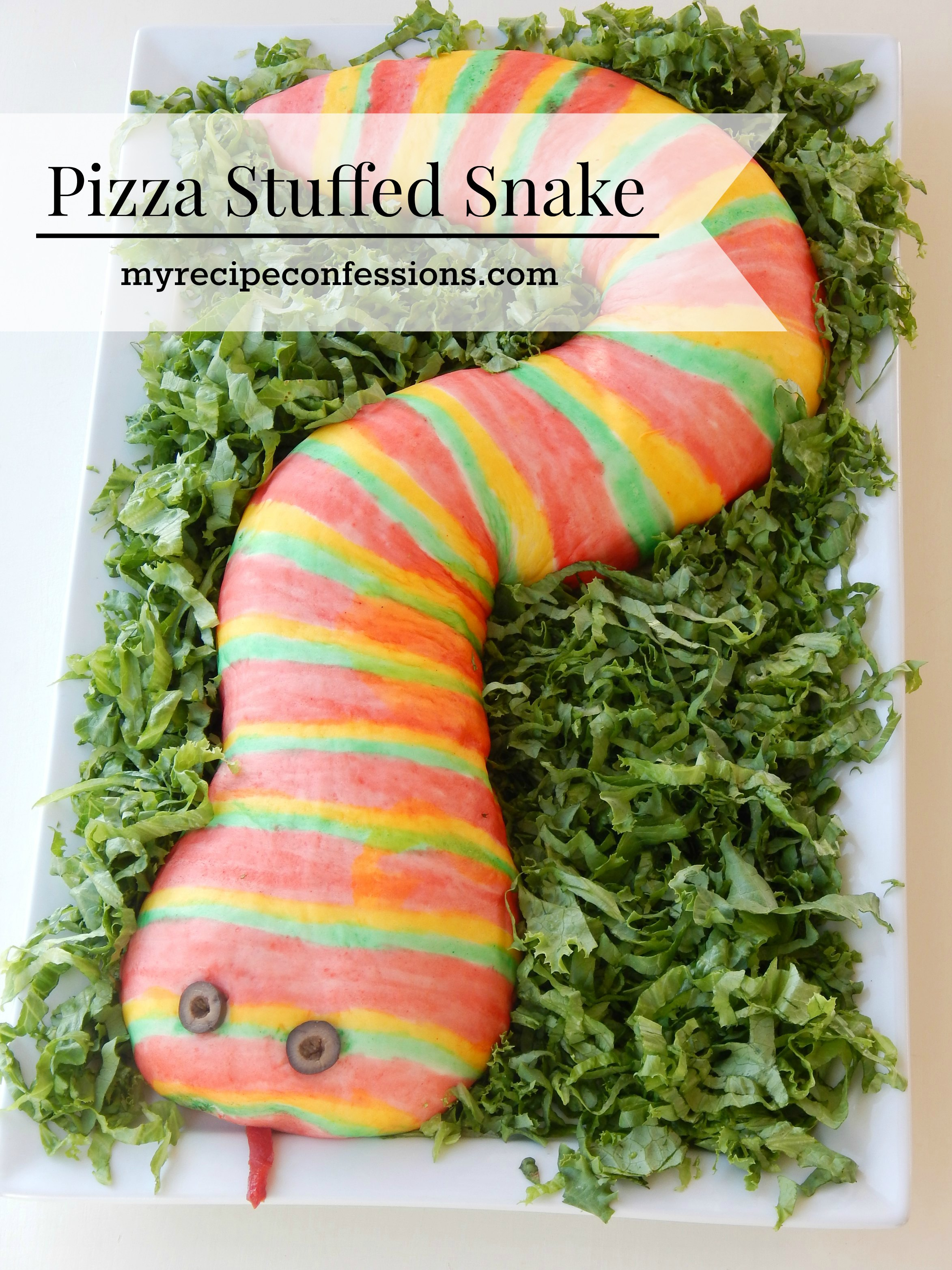 Pizza Stuffed Snake- This easy to follow recipe and tutorial is my boys favorite! You can customize it with your favorite pizza toppings. My kids love to help paint the snake. You will be shocked how simple the food coloring paint is to make. This snake is a great main dish to serve at a Halloween party, birthday party, or Harry Potter party. Serve it with a side of blood a.k.a marinara sauce for a huge party hit!