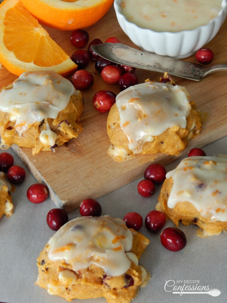 Pumpkin Cranberry Cookies with Orange Glaze are all the best holiday flavors combined into one amazing cookie! This cookie has all the delicious fall flavors we all love ! This is my new favorite holiday cookie recipe!