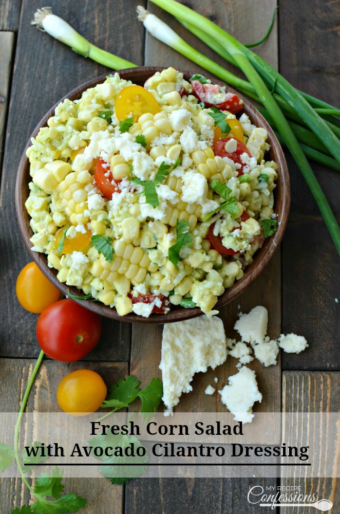 Fresh Corn Salad with Avocado Cilantro Dressing-Look no further for the perfect side salad. This recipe is a must try for sure! It is a vegetarian, gluten-free salad that everybody will enjoy. The avocado cilantro dressing is so good I could drink it from a cup. On top of everything, else it is super easy to make too.