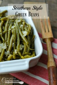 Southern Style Green Beans are the best green beans ever! They are cooked low and slow and as easy as can be. The smoky flavor makes these beans irresistible. I always get asked for the recipe and everybody is always surprised at how easy they are. They are a great side for any holiday dinner.