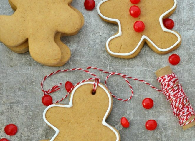 Easy Homemade Gingerbread Ornaments are quick, and easy alternative to making a gingerbread house. My kids love to make these ornaments and hang them on the tree. If you are like me and love to make DIY gingerbread house from scratch, this is a great recipe for that too. These ornaments smell so good and make the perfect Christmas family tradition!