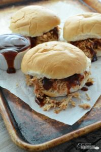 Pressure Cooker BBQ Chicken Sandwich is the easiest and quickest way to make a pulled chicken sandwich. Making this recipe in the crock pot would take most of the day. In the pressure cooker it will take less than 90 minutes. This chicken is honestly the BEST EVER!!!