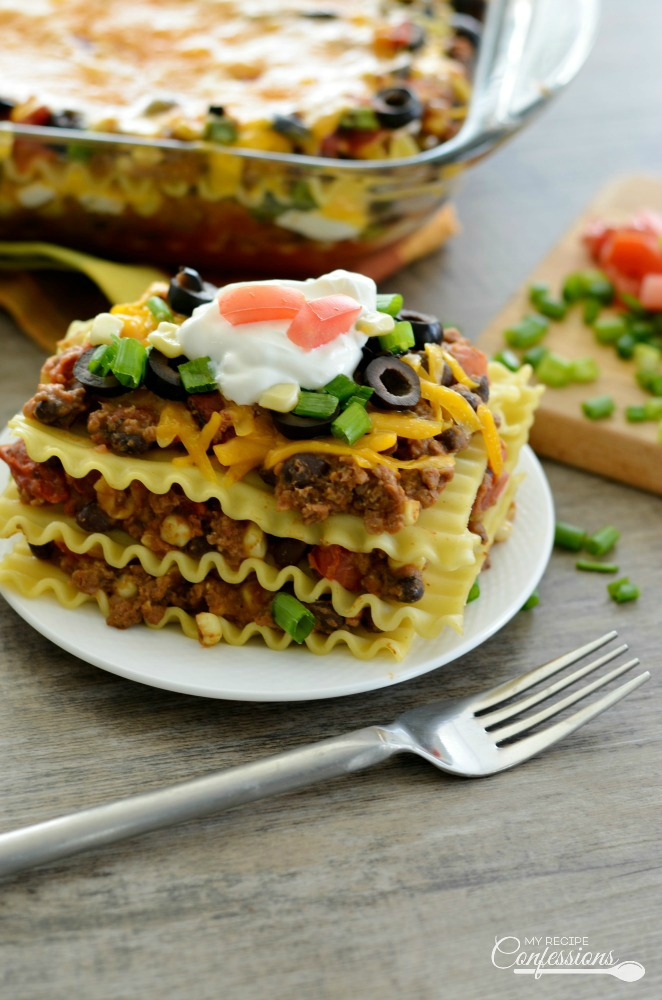 Taco Lasagna is a quick and easy family friendly recipe. If you love Mexican food, you will love the layers of noodles, ground beef, beans, cheese and more. This recipe is going to rock your world!